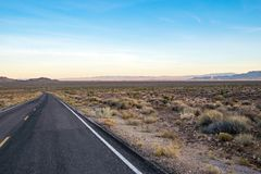 County road in Arizona, USA. Picture of an empty county road in the desert in Arizona, USA stock image