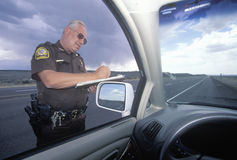 County sheriff giving speeding ticket, New Mexico Royalty Free Stock Images