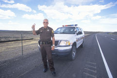 County sheriff with handcuffs Stock Images