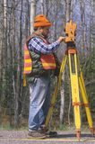 County surveyor and his equipment Royalty Free Stock Images
