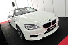 Coupé di BMW M6 Gran su esposizione alla manifestazione 2013 dell'yacht di Singapore Immagine Stock