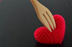 Coup en bois de fourchette au coeur Photo libre de droits