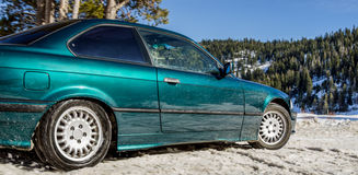Coupe car on a snow road Stock Photo
