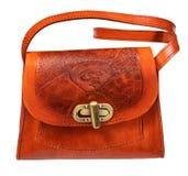 Coupe-circuit de sac à main de cuir de relief d'orange sur le blanc images libres de droits