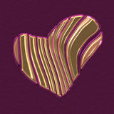 Coupe de forme d'or de coeur sur différentes pièces Photo libre de droits