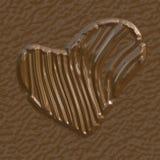 Coupe de forme de coeur de chocolat sur différentes pièces Photo stock