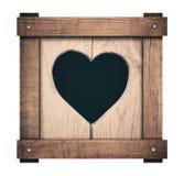 Coupe de forme de coeur sur les planches en bois et le cadre vissé Images stock