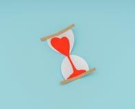 Coupe de papier des coeurs dans l'horloge de sable Photo stock