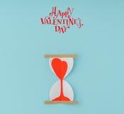 Coupe de papier des coeurs dans l'horloge de sable Image stock