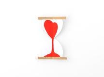 Coupe de papier des coeurs dans l'horloge de sable Photo libre de droits