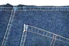 Coupe de tissu de blues-jean Photo libre de droits