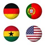 Coupe du monde du football drapeaux de 2014 groupes G sur des soccerballs Photographie stock