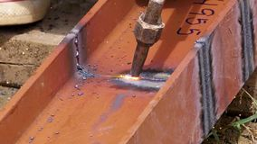 Coupe en métal avec la chaleur à la main Photo libre de droits