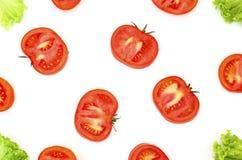 Coupe et laitue de tomate sur un fond blanc 2 image libre de droits