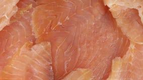 Coupe saumonée en tranches minces banque de vidéos