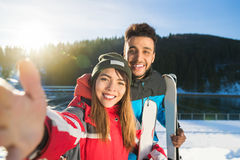Coupe Ski And Snowboard Resort Taking Selfie Photo Winter Snow Mountain Mix Race Man Woman Stock Image