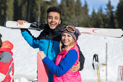 Coupe Ski And Snowboard Resort Winter Snow Mountain Hispanic Man  Woman Embrace Holiday. Coupe Ski And Snowboard Resort Winter Snow Mountain Hispanic Man And Royalty Free Stock Photo