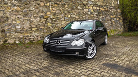 Coupe sport car, german vehicle, big alloy rims/wheels, foldable mirrors. Cluj-Napoca,Romania - August 08,2017:Isolated Mercedes-Benz CLK class-alias W209,black Stock Photos