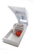 Coupeur blanc de pillule Photographie stock