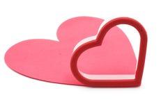 Coupeur de biscuit et couvre-tapis rose Photographie stock
