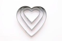 Coupeur en forme de coeur de biscuit Images stock