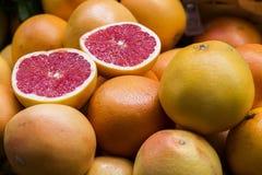 Coupez l'orange colorée Photos stock
