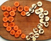 Coupez la carotte et la banane avec du chocolat de sucre Photo libre de droits