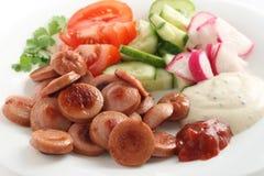 Coupez la saucisse avec des légumes Photo stock