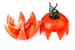Coupez la tomate sur le blanc. photographie stock