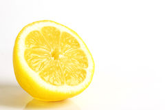 Coupez le citron sur le fond blanc Images stock
