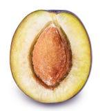 Coupez le fruit de prune d'isolement sur le fond blanc Photographie stock libre de droits