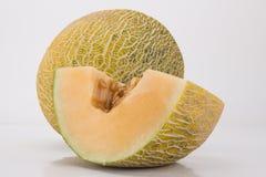 Coupez le melon de hami Image libre de droits
