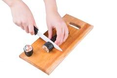 Coupez le petit pain de sushi Image stock