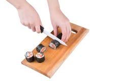 Coupez le petit pain de sushi Photo libre de droits