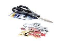 Coupez les cartes de crédit Photo libre de droits