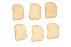 Coupez les morceaux de pain blanc sur le fond blanc Photographie stock libre de droits