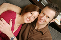 Couple. Posing on couch for a portrait Royalty Free Stock Photography