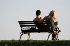 Couple. ON A PARK BENCH stock images
