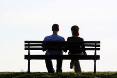 Couple. Sitting on a park bench Royalty Free Stock Photos