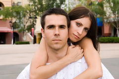 Couple. A man and a woman looking into camera Stock Photos