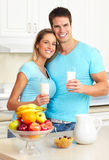 Couple. Young beautiful smiling couple drinking milk at home Royalty Free Stock Photo
