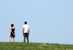 Couple. On a dike near the sea Royalty Free Stock Images