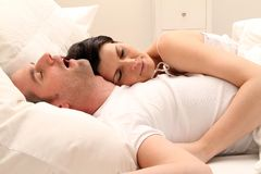 Couple. White couple laying together in bed stock image