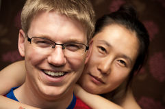 Couple. A smiling couple - white caucasian man with Asian woman Royalty Free Stock Photography