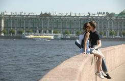 Couple. Young adults on the bank of Neva river/ St-Petersburg Stock Photos