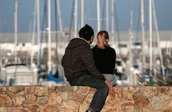 Couple. On a wall at a pier Stock Photo