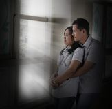 Couple. Hugging next by window with light ray Stock Photos