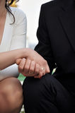 Couple. Man and woman holding hands during their wedding Royalty Free Stock Photos