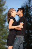 Couple. Young couple kissing in park royalty free stock photos