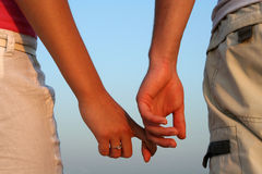 Couple. A couple holding each other's hand Stock Photo